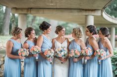 Beautiful bouquets using pastel peach roses, blue hydrangeas, hypericum berries and dusty miller designed by Phillip's Flowers. Image by Larissa Marie Photography.