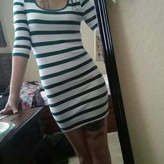 Green/white striped dress 3/4 length sleeves with U-neck. Stretchy material hugs the body. Only worn a handful of times. Forever 21 Dresses Mini