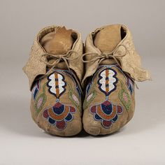 These are a great pair of very dramatic and colorful Cayuse woman's moccasins. The beads used in the designs are all very tiny faceted seed beads in a broad range of colors including three different b