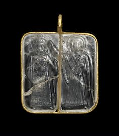 The square pendant with narrow gold border encloses a rock crystal cameo engraved with standing figures of the Emperor Romanus III Argyrus (1028-34) crowning the Empress Zoe ( 1028-50), daughter of his predecessor Constantine IX. Accompanied by a gold coin of the same subject. Byzantine, 11th century.