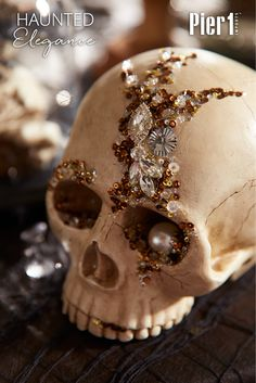 This bejeweled skull is a part of Pier1's Haunted Elegance Collection, a more sophisticated take on Halloween. What our handcrafted skull lacks in rosy cheeks, it makes up for in bling. Place it on a mantel, shelf or console table, or create a bejeweled centerpiece around it. However you decorate, it's sure to be deathly fabulous.