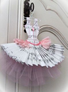 Beautiful paper tutu (strung together, what a cute banner it would be)
