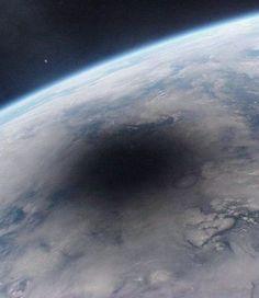 Earth during solar eclipse (Moon shadows)