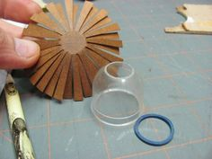 When the spokes are dry, glue the 2 spokes together at the center offsetting the spokes. I use Elmer's glue. My diagram was hand drawn b...