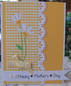 sweet handmade card: Happy Mother's Day ... yellow and white ... patterned papers in polka dots and checks ... delicate die cut daisies ...