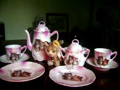 """This child's tea set is not marked but is most-likely German, dating from about 1905. If you're a collector of cat and kitten items, you know that many items featuring lovable felines were produced during the Victorian era. A change in the social status of cats and the charming cat-themed artwork of artists like Louis Wain helped to make cats """"en vogue!"""""""