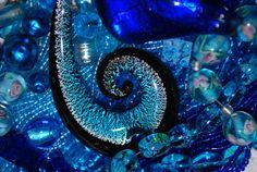 Assorted blue glass beads