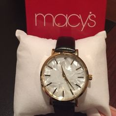 Watch Ladies mother of pearl watch with blk leather straps. Brand new. Was a gift with Macy's perfume purchase. Accessories Watches