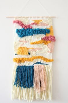 Pink, blue, and fuzzy too. This woven wall hanging has it all.