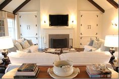 awesome cabinetry flanking fireplace. like exposed beams.
