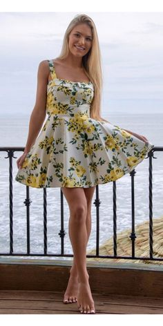 The Pretty Floral Dress in Yellow is ready to please any 50's loving bombshell. Gorgeous yellow and green rose print covers this white cotton beauty for a vintage-inspired look that wows. Thick straps, a cute collared neckline and padded bust with structured seams gives this mini swing dress a super flattering fit. The flowing skirt and waist cinching back tie creates that coveted hour glass shape. Wear with tall cut out heels and a kiss lock hand bag for an irresistible classic look.