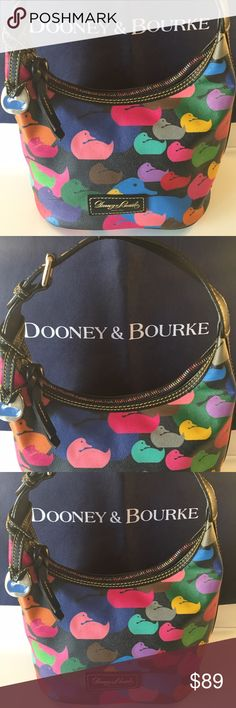 🌟DOONEY & BOURKE SHOULDER BAG 💯AUTHENTIC DOONEY & BOURKE SHOULDER BAG 100% AUTHENTIC. WHAT A PRETTY BAG! SO LOVELY AND STYLISH. PERFECT FOR ANY OCCASION AND TOTALLY ON TREND. THIS WONDERFUL BAG IN A BRIGHT CHEERY DOONEY PRINT! THIS GREAT BAG HAS THREE INTERIOR WALL POCKETS. THE BAG MEASURES 10 INCHES WIDE BY 8 INCHES TALL. IT DOES HAVE A BIT OF INTERIOR SMUDGING. THE ADJUSTABLE SHOULDER STRAP HAS A 7 INCH DROP! SUCH A PRETTY BAG FOR ANY TIME OF YEAR. IT IS MULTI COLORED Dooney & Bourke…