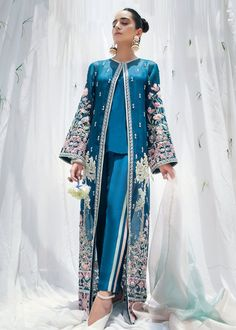 Includes : Jacket : Organza Undershirt : silk Pants : Rawsilk Dupatta : Organza Product Description: The garment is a Sapphire blue front open jacket with high side slits to give it a modern chic look Pakistani Fashion Party Wear, Pakistani Wedding Outfits, Pakistani Dresses Casual, Pakistani Dress Design, Indian Dresses, Indian Outfits, Indian Fashion, Wedding Hijab, Wedding Dresses