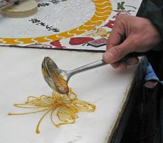 Edible Art: Sugar painting (originated during the Ming Dynasty). Hot sugar [melted solid malt sugar] drizzled over a marble surface. When completed, a bamboo stick is used to hold the art, place in a plastic bag and given to customers. Good for a kids party!!