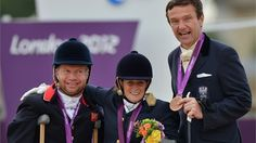 Lee Pearson collects his silver medal at the London Games