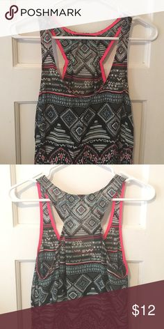 Racer back tank top Flowy racer-back tank top. Shorter in front and longer in back. Tribal pattern. Great for summer! Only worn a few times! American Eagle Outfitters Tops Tank Tops