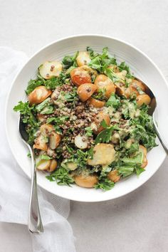 A crowd pleasing spring salad with a creamy lemon caper dressing. Packed with kale, beluga lentils and roasted new potatoes. Vegan + Gluten Free.