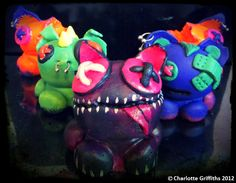 """The """"trash tlk gang"""" are my first character creations! Using bright colours, and an alternative storage solution for piercings, these mischievous little creatures have found a place in my heart! Using air dry clay, acrylic paint and steel piercings."""