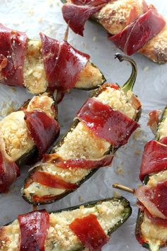 Prosciutto-Wrapped Four Cheese Stuffed Jalapeños - loaded with 4 cheeses, topped with a buttery cracker crumb, and wrapped in Italian prosciutto.