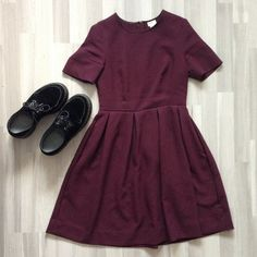Wore this to a funeral, it's so simple and yet beautiful and classy and chic and pretty. I love the color, i dont know what color it exactly is though. On the photo it looks like dark red/burgundy, but it's actually more purple-y...Whatever, I love it! The only things that annoys me about this dress is that the zipper is always opening itself...I have to fasten it with a safety pin!!! oh well...and the dr martens, theyre my favorite shoes. black velvet, platform, creepers, favorite shoes
