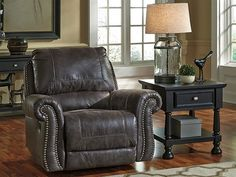"Ashley Furniture, Rocker/ Recliner; Inches: 43"" W x 40"" D x 40"" H. More Dimensions: Reclined footrest height 20"".Distance between arms 22"". Fully reclined length 66"" Seat depth 23"".Seat height 20"".Distance between recliner and wall 12"".Minimum width of doorway for delivery 32"". Distance Between Inside arms 26"". Arm height 26"". Distance from Floor to Top of Footrest (Reclined) 20"""