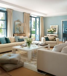 Duck egg blue with cream sofas and wood floor