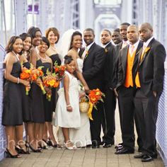 The bridesmaids wore black silk shantung A-line dresses from Jim Hjelm with a sash at the waist. The bride gave them each a silver pearl necklace, bracelet, and earrings to finish the look.