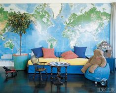 The boys' playroom in a Florida home is given a global perspective with the use of a world map as wallpaper.   - ELLEDecor.com