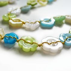 Necklace - pastel string of flower buttons