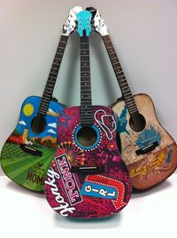 One-of-a-Kind Guitars inpsired by Dierks Bentley, Loretta Lynn, The Band Perry, Keith Urban, and more for the Guitars of the Stars Auction at CMA Music Fest 2012