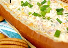 Mississippi Sin Dip - 16 Ounces - Sour Cream 8 Ounces - Cream Cheese, at Room Temperature 2 Cups - Sharp Cheddar Cheese, Shredded 1/2 Cup - Ham, Chopped 1/4 Cup - Green Onion, Sliced Few Dashes or to Taste - Hot Sauce 1 Teaspoon - Worcestershire Sauce 1/4 Teaspoon - Black Pepper 1-16 Ounce. - Loaf French Bread, Unsliced
