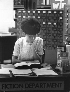 1960s Fiction Department, 1960s hair | via the swinging sixties.  (P.S.  This is not what librarians really do all day.  But cute picture!)