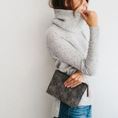 A great clutch and oversized turtleneck are all you need