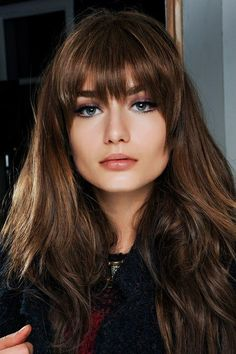 Full long fringe bangs with blended layers on cinnamon brown hair