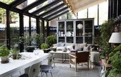 Ett Hem Stockholm. Beautiful sunroom. Great use of this space.