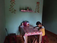 Kim Huyen does homework at the dining table of her parents' Habitat home (Vietnam) Habitat For Humanity, 10 Year Old, Better Life, Homework, Habitats, Vietnam, Parents, Dining Table, Inspirational