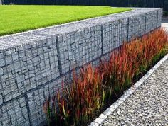 gabion retaining wall, 2 rows of gabions in a brick bond pattern http://www.gabion1.com