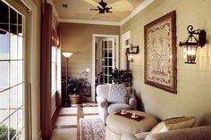 Love the coziness and beautiful details of this sunroom