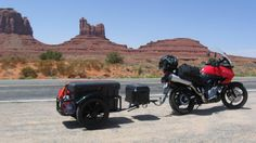 The single wheeled trailers are attached with a fixed setup and lean into corners with your bike. Description from pbmotorcycletrailer.com. I searched for this on bing.com/images