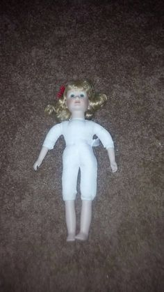 Check out this item in my Etsy shop https://www.etsy.com/listing/212881161/anco-1993-porcelain-doll-with-soft-body