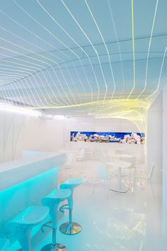 Bar Aquarium / Next Level Studio. The ceiling is lit in small lines and grids to replicate a 'net' that is used for animation. The small sections of fluorescent colour against large areas of white, give off a ethereal glow. 3d Studio, Design Studio, Deco Design, Interior Exterior, Interior Architecture, Interior Design, Minimalist Architecture, Studio Interior, Home Design