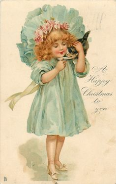 A HAPPY CHRISTMAS TO YOU girl in blue holding a kitten feeding it milk - TuckDB