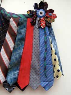 This is a wrap round skirt which fixes anywhere with the corsage pin and therefore fits any size. Recycled men's ties.