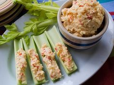 Pimento Cheese : Pimento cheese has long been regarded as a food group in the South. Once found only on white bread, stuffed in tomatoes or slathered on a celery stick, it now can be found as a burger topping, melted on french fries, spooned into grits, as a chili topping, and even breaded and deep-fried.