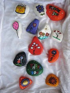 http://purplecandy.hubpages.com/hub/PAINTING-AND-DRAWING-ON-STONES