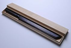 "Yoshihiro- Ebony Damascus Sakimaru Takobiki Sushi Chef Knife with Ebony Saya13"" 330mm in Wooden Box - Made in Japan by YOSHIHIRO. $1209.99. Hardness Rockwell C scale: 64. Grade: Ebony Damascus (Suminagashi) / Knife Type: Sakimaru Takobiki. Blade: Single-Edged/ Blade Length: 13"" (330mm). Steel Type: Yasuki Aoko One (The Best Knife Material). BOLSTER: Water Buffalo Horn (BOLSTER COLOR -VARIES) / Handle Material: Ebony. Suminagashi (Damascus) knives are made by folding and..."