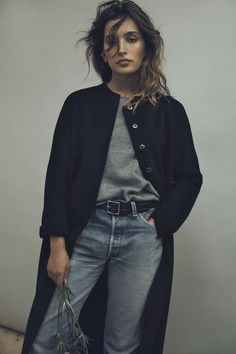 Grey tee + blue denim jeans + statement black coat. Now only if I could get my legs to look like that!!   Shop denim at www.refinedtrends.com