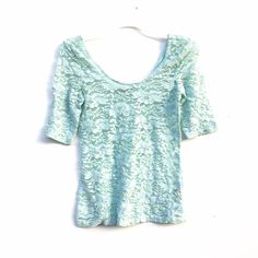 Mint Lace Top Short sleeve & lace mint green top, scoop back and neck, very comfortable and easy to style. Works for sizes small to medium. Tops