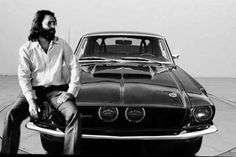 Rock star Jim Morrison from The Doors with his 1967 Night Mist Ford Mustang Shelby that he nicknamed 'The Blue Lady'. Jimmy Morrison, Morrison Hotel, Ray Manzarek, Gainsbourg Birkin, Serge Gainsbourg, The Doors Jim Morrison, Music Pics, American Poets, The Doors Of Perception