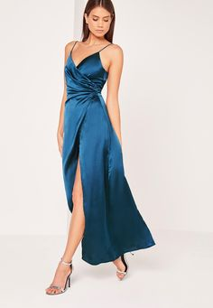 There's nothing sexier than a silky satin dress and this maxi will make you looked like you dropped some serious dollar. In a vintage teal blue, silky feel, cinched wrap over around, side split and maxi length, you'll be bringing in the max...